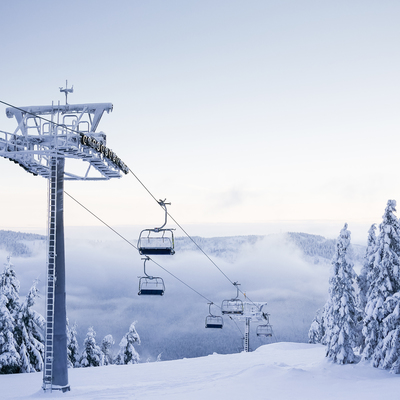 Empty chair ski lift on bright winter day picjumbo com